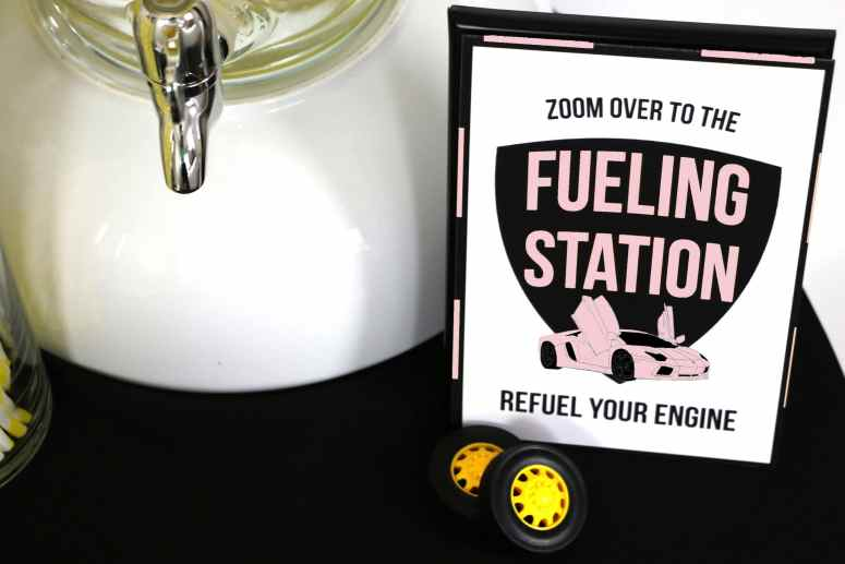 Supercar party supplies in every color: Pink Fueling Station Sign