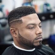 box haircut with design fade