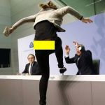 Mario Draghi being attacked
