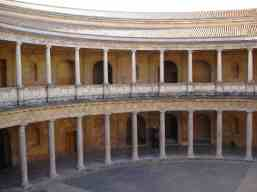 Inside the Palace of Charles V; austere, almost aggressive, Christian.