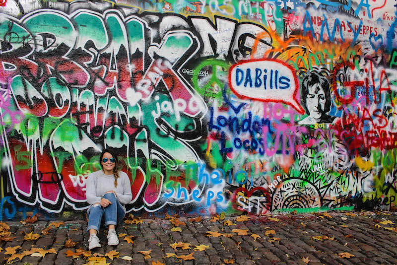 Taylor Fuller in front of John Lennon wall in Florence