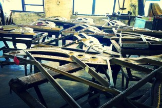 Iron plates heading for the piano's belly.