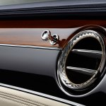 Bentley Continental GT review (2019): Wood and Alcantara dash surrounding the circuilar air vents in chrome