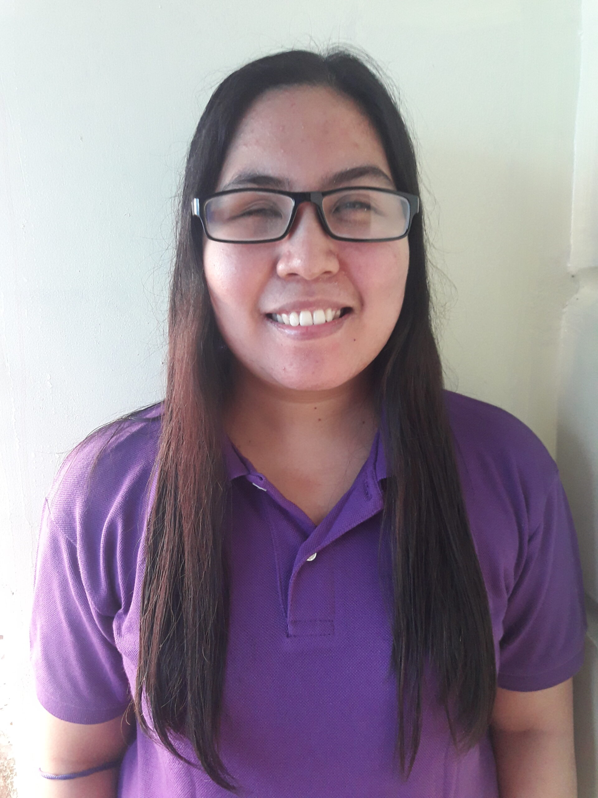 Ms. Nerikka wearing a violet polo shirt
