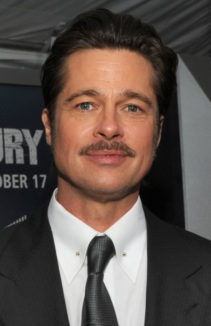 """Actor Brad Pitt, the star of the movie, who plays the part of """"Wardaddy/Don Collier"""", gives interviews with the Mr. John Bradley and Lisa Fernandez of the Defense Media Activity on the """"Red Carpet"""" during the world premiere of the movie Fury at the Newseum in Washington D.C. (Department of Defense photo by Marvin Lynchard)"""
