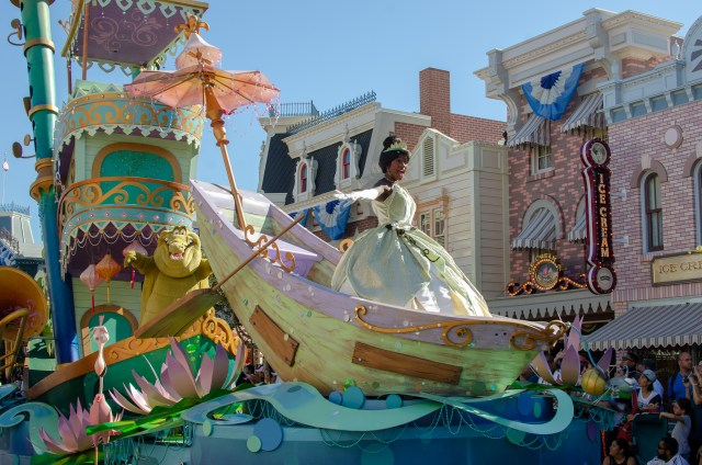 Princess in green gown, atop a float created to look like a row boat