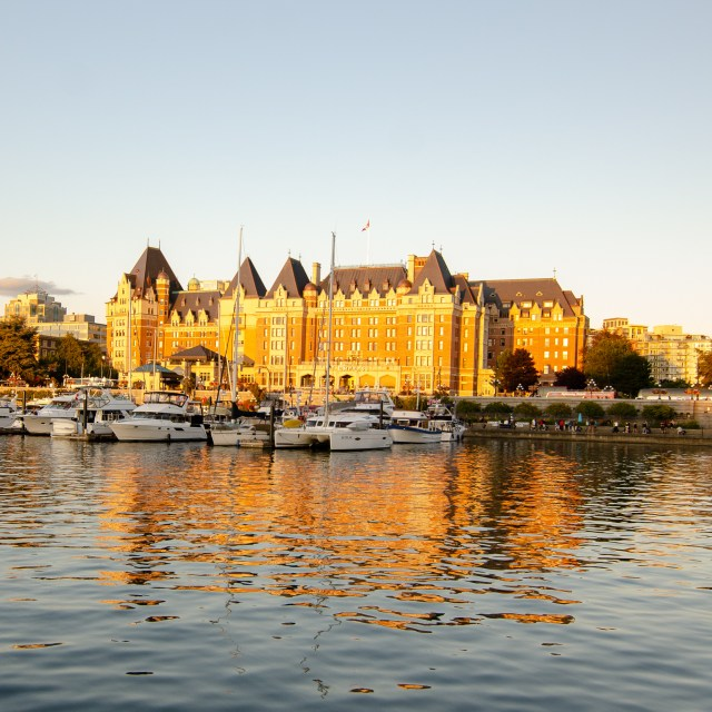Golden hour reflecting on Fairmont Empress, an old looking hotel, one of the top things to do in Victoria, BC