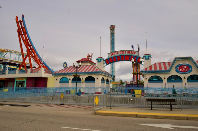 Usually flashy and busy entrance to Santa Cruz boardwalk sits still, with ticket booth closed, no people in sight and the rides not running