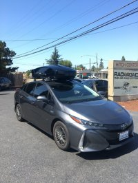 Prius Prime with Thule roof rack and Thule Motion XT Cargo