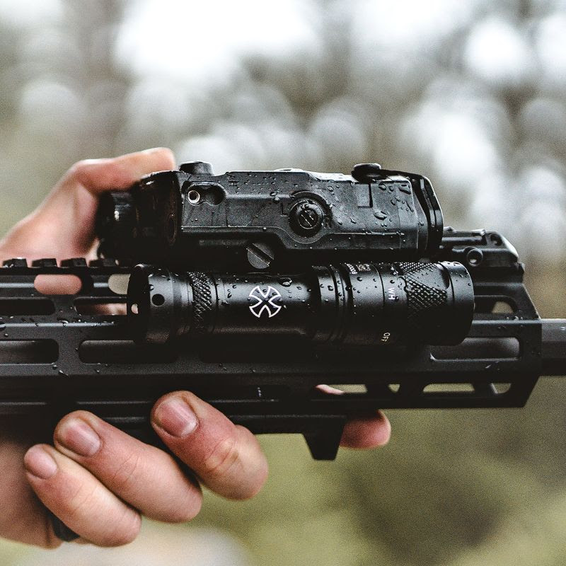 noveske peq15 laser light mounts directly to the PEQ super tight to rail surefire light 5.jpg