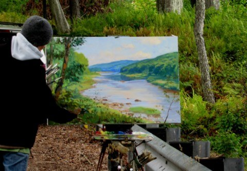 Judith Reeve painting on site along the Delaware River