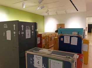 Art crates adjusting to the climate space before being unpacked.