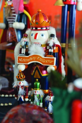 ALTA VISTA: A winter village cottage; an ornament from the storybook tree; a nutcracker from the family's collection.