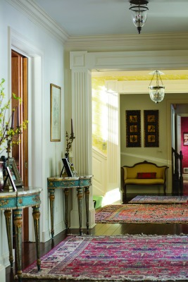 Today, Hillcroft still has a grand feeling with a wide, center hallway delineated with a series of openings framed with elaborate millwork.