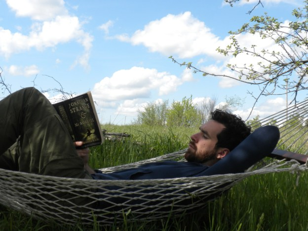Man reading hammock