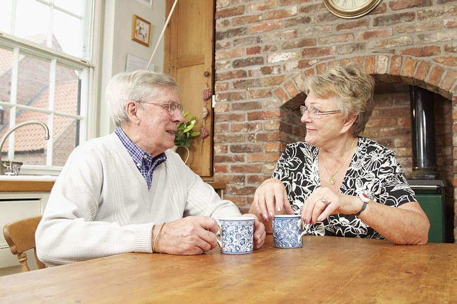 Couple having a coffee image