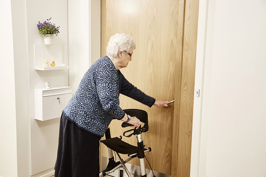 Tunstall Connected Care Homes Assistive tech elderly woman