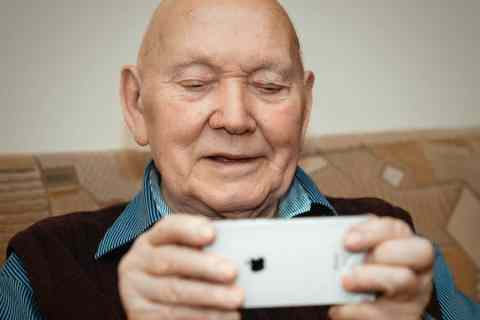 Older adult with iPhone image