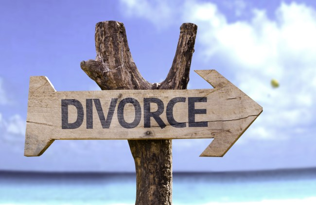 Divorce wooden sign with a beach on background