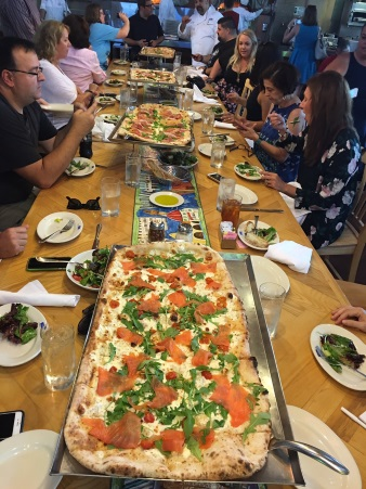 Via Napoli's pizzas on a table