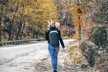 A girl is backpacking