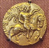 Gold coin of Gupta era, depicting Gupta king Kumaragupta holding a bow.