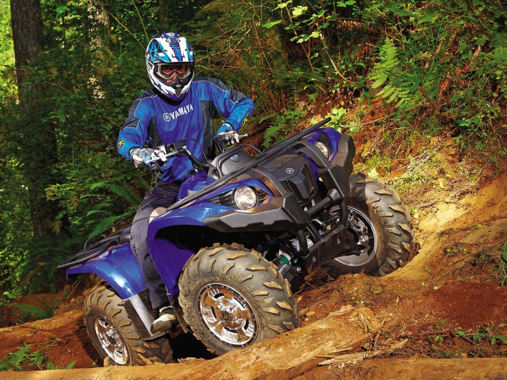 medium resolution of 2011 yamaha grizzly450eps front right blue rididng over