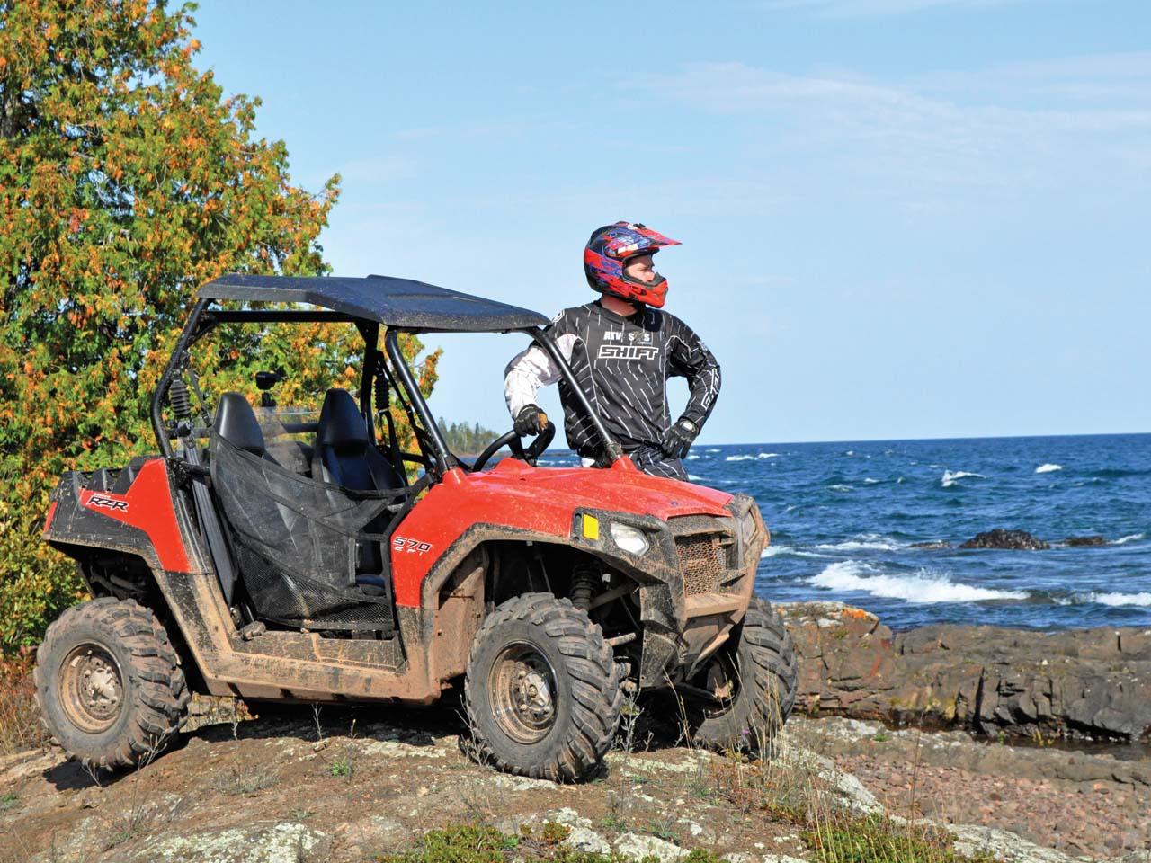 hight resolution of 2012 polaris rzr570 red right parked on rocks