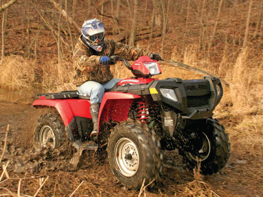 medium resolution of tech troubleshooter polaris sportsman ignition fix atv illustrated2013 poalris sportsman red front right riding through
