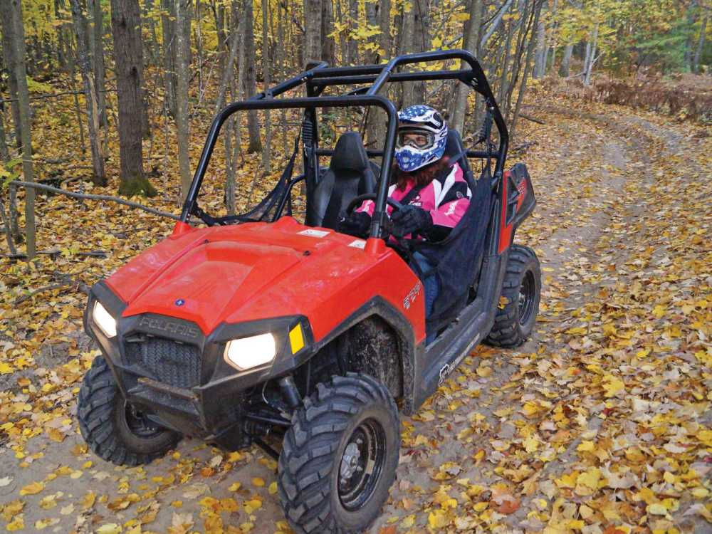 medium resolution of 2013 polaris rzr570 red front left riding on
