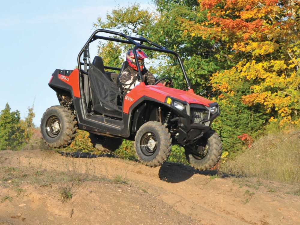 medium resolution of 2013 polaris rzr570 red front right jumping in