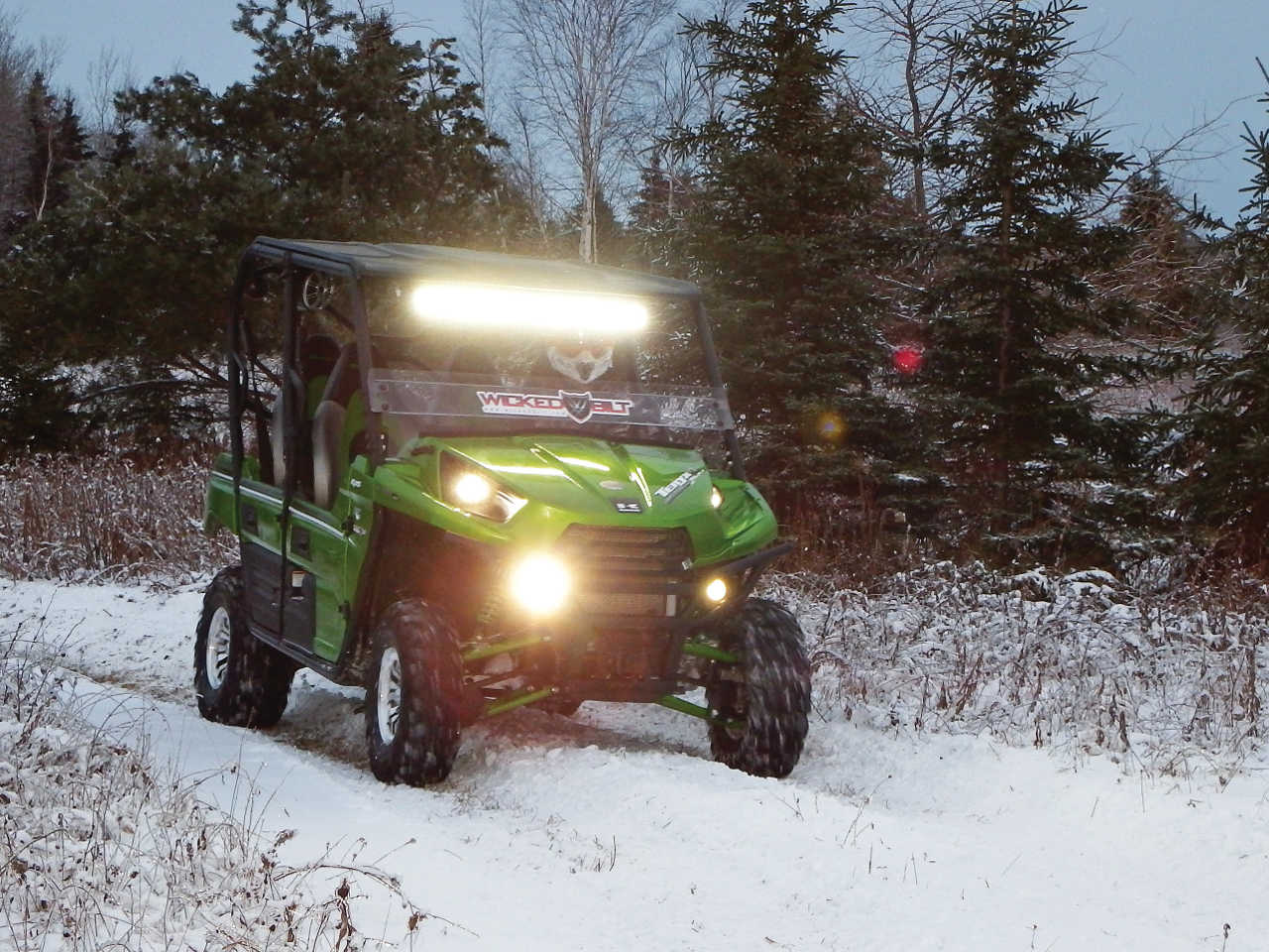 hight resolution of 2014 kawasaki teryx4 green front right riding on