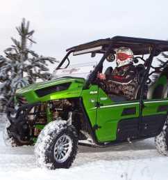2014 kawasaki teryx4 green left riding on snow  [ 1280 x 960 Pixel ]