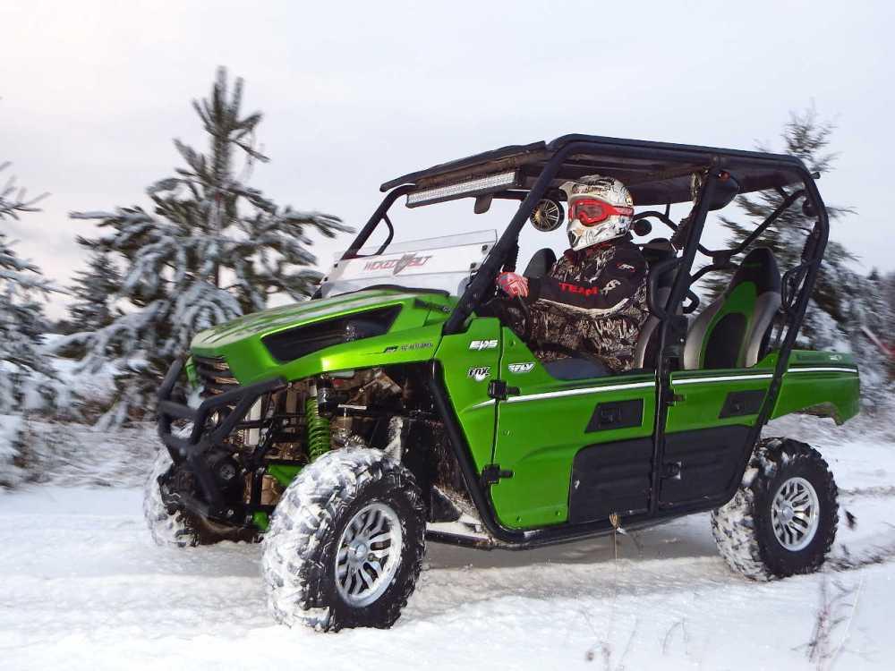 medium resolution of 2014 kawasaki teryx4 green left riding on snow