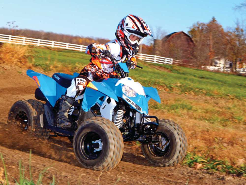 medium resolution of 2014 polaris outlaw90 front right blue riding on