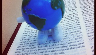 "My bible with a ""walking"" globe toy on the story of Noah's covenant."