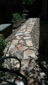 Flagstone walkway with natural river rock in austin,texas