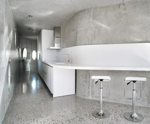 365235-_A_Corian_counter_and_backsplash_hug_the_kitchen_wall_Photograph_by_David_Frutos_Bis_Images_