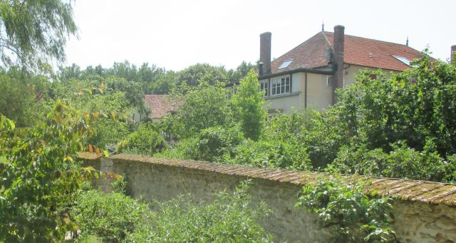 Le Moulin Better view of grounds and main home to the right.
