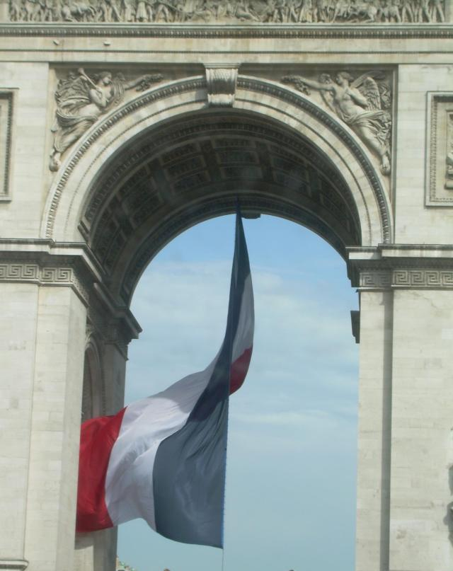 Paris. Arche de Triomphe with flag.