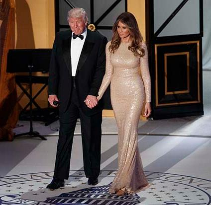 Vice President-elect Mike Pence, left, and his wife Karen, second from left, applaud as President-elect Donald Trump and his wife Melania arrive for a VIP reception and dinner with donors, Thursday, Jan. 19, 2017, in Washington. (AP Photo/Evan Vucci)