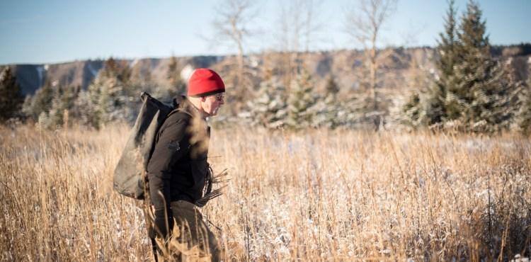 Atz Kilcher walking in the Alaskan Wilderness