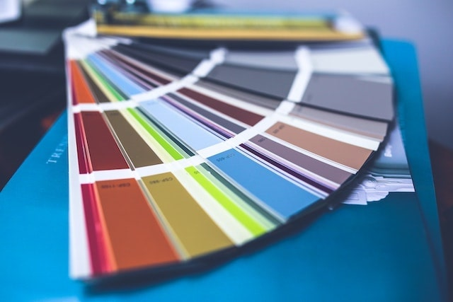 Color samples fanned out across table