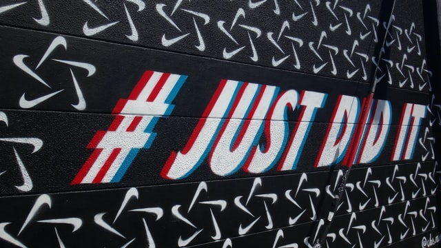 Nike just did it hashtag painted on a gym wall