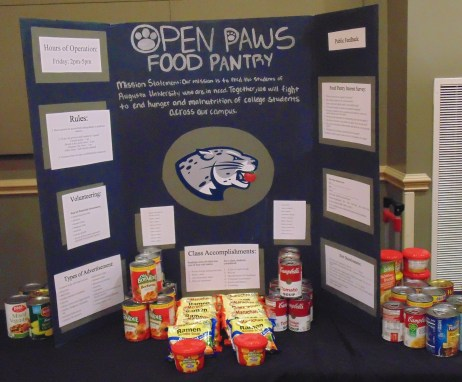 "Here is a poster board on ""Open Paws Food Pantry,"" which discusses the goal of helping Augusta University students who deal with hunger and malnutrition. (Photo: Jamie Sapp)"