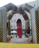 A group of students play on the Wrecking Ball bounce house at the Oak Hall courtyard. (Photo: Jamie Sapp)
