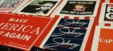 Here are some signs placed on a table from the Augusta University College Republicans. (Photo: Kait Fruechting)