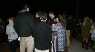 Students and guests gather around for a moment of silence in prayer for Katie Rogers. (Photo: Jamie Sapp)
