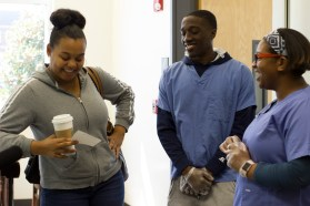 The Agency students, Amisha Johnson and Keshun Sherrill, invited students to take a dose of The Effect on Mar. 15. in the JSAC Breezeway. (Photo: Kait Fruechting)