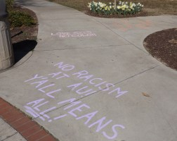 Chalk messages of protest and support were placed near the AU Teardrop on Feb. 13. (Photo: Jamie Sapp)